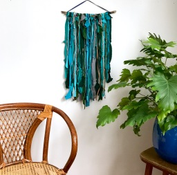 Recycled Clothing in vivid colors for a modern wall decor.